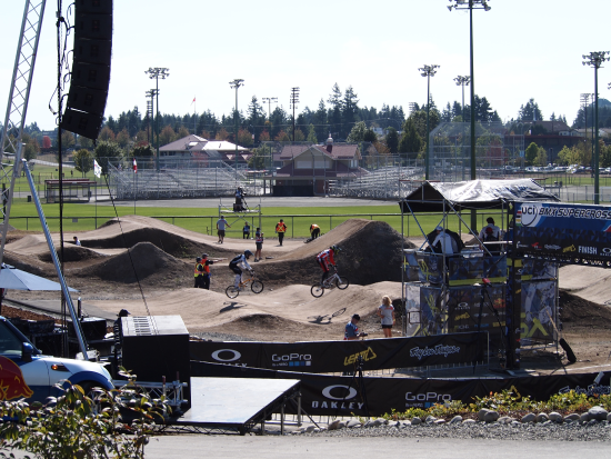 Several BMX cyclists on track at 2012 event